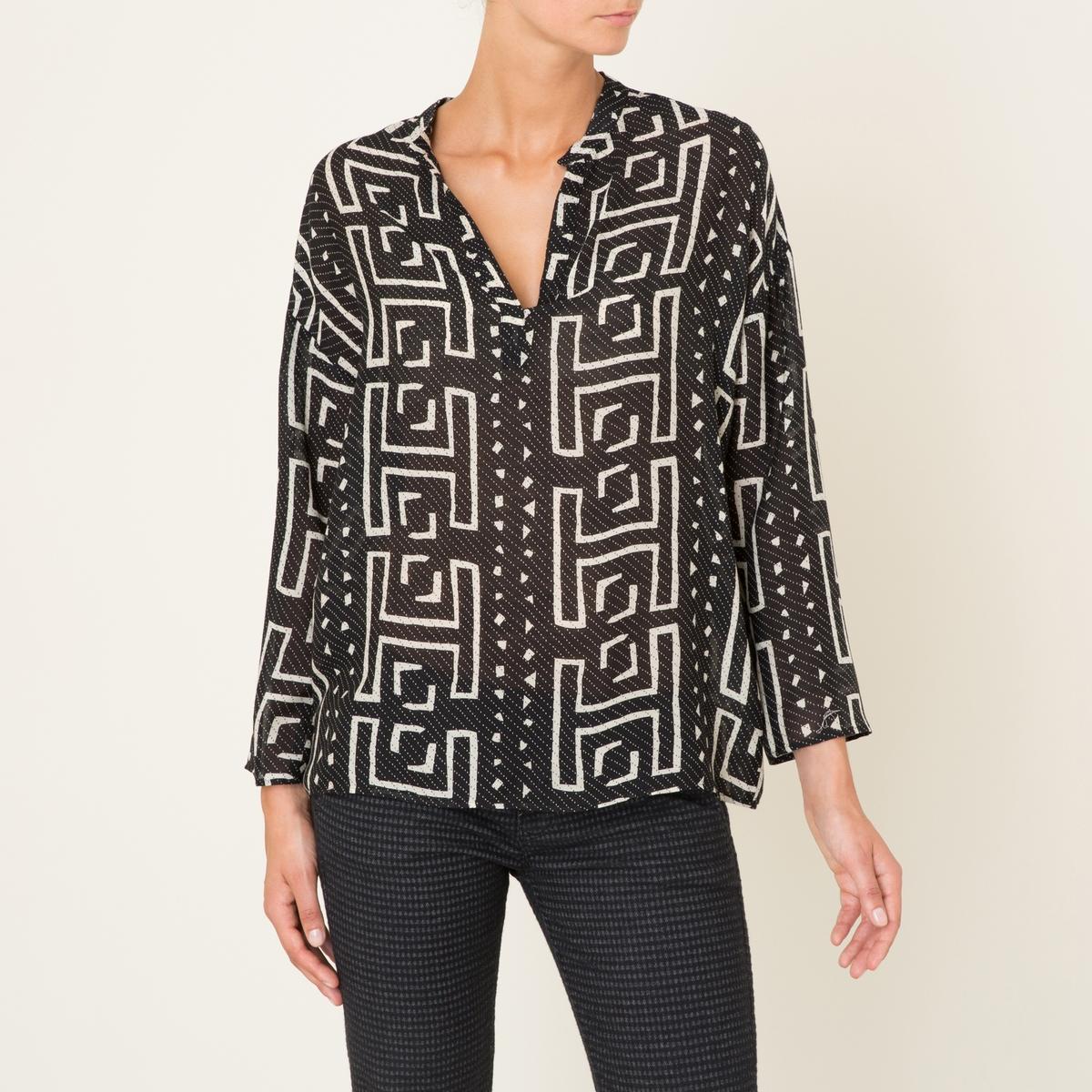 Блузка GUITARAБлузка DIEGA - модель GUITARA из шелка и шерсти. Сплошной принт. Тунисский ворот. Длинные рукава. Прямой покрой. Состав &amp; Детали Материал : 73% шелк, 27% шерстьМарка : DIEGA<br><br>Цвет: черный