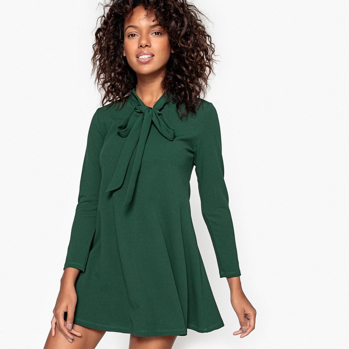 Платье однотонное короткого и расклешенного покроя с длинными рукавамиДетали •  Форма : расклешенная •  Укороченная модель •  Длинные рукава    •  Галстук-бантСостав и уход •  5% эластана, 95% полиэстера  •  Следуйте рекомендациям по уходу, указанным на этикетке изделия<br><br>Цвет: зеленый английский,коньячный<br>Размер: XL.M.S.S.XS.L