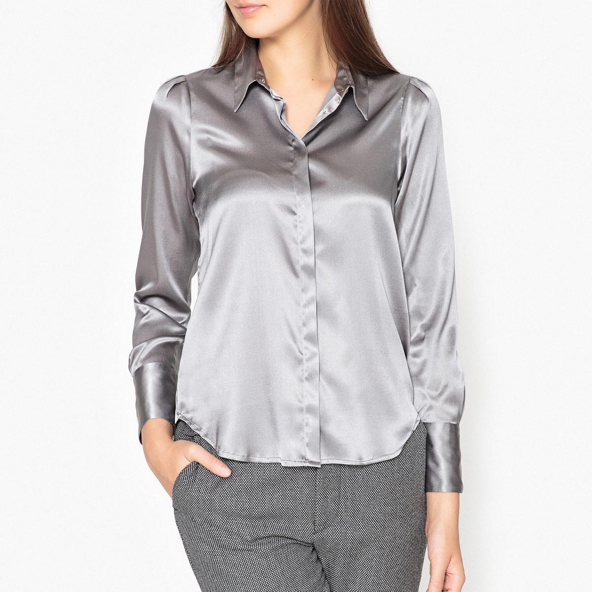 Рубашка ARIELLEРубашка с длинными рукавами MOMONI - модель ARIELLE с закругленным низом, уголками воротника без застежки, из блестящей шелковой ткани.Детали •  Длинные рукава •  Покрой бойфренд, свободный •  Воротник-поло, рубашечный Состав и уход •  93% шелка, 7% эластана •  Следуйте советам по уходу, указанным на этикетке<br><br>Цвет: серебристый