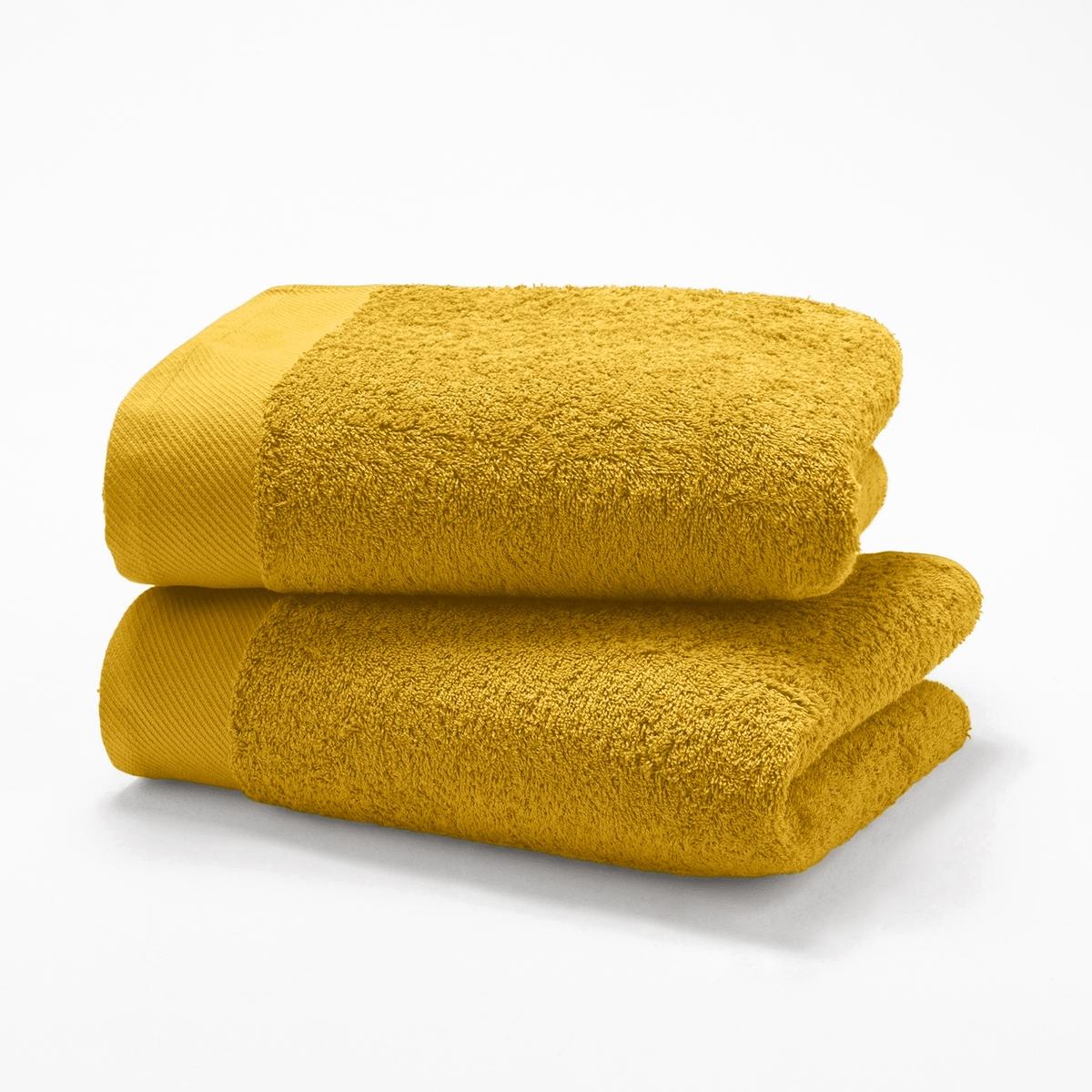Комплект из 2 полотенец из махровой ткани 500 г/м?Характеристики 2 однотонных полотенец :- Махровая ткань, 100% хлопок (500 г/м?).- Отделка краев диагонали.- Машинная стирка при 60 °С.- Машинная сушка.- Замечательная износоустойчивость, сохраняет мягкость и яркость окраски после многочисленных стирок.- Размеры полотенца : 50 x 100 см.- В комплекте 2 полотенца. Знак Oeko-Tex® гарантирует, что товары протестированы и сертифицированы, не содержат вредных веществ, которые могли бы нанести вред здоровью.<br><br>Цвет: желтый шафран