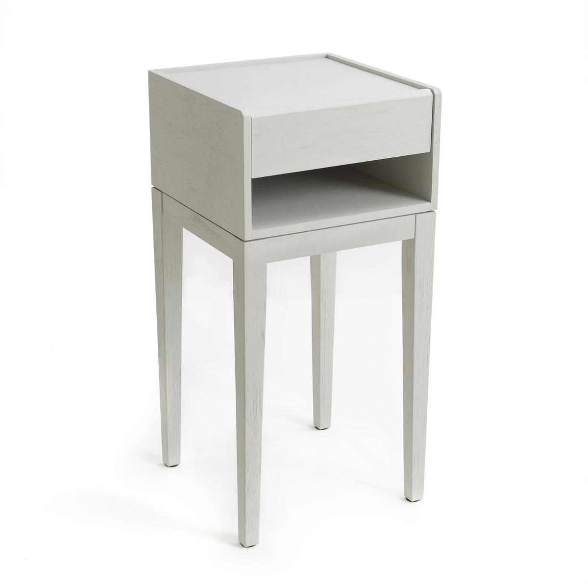 Столик прикроватный  Nizou, Design E.GallinaПрикроватный столик Nizou, эксклюзивное творение Эммануэля Галлины  для AM.PM   .Прикроватный столик без излишек. Один материал, простота и утонченность - главные характеристики этого изделия. Высокие и утонченные ножки, практичные комоды - предметы утонченной коллекции, которые естественным образом впишутся в Ваш интерьер.Дизайнер - Эммануэль Галлина. Элегантность, очевидность и простота - ключевые критерии его работ, которые отличают тонкая проработка деталей, формы и функциональности каждой модели .Описание :- Модель натурального цвета: из дубовой фанеры с полиуретановой отделкой, модель серого цвета с покрытием краской.- 1 ящик- 1 ниша с отверстием для проводов. - Ножки из массива дуба с полиуретановой отделкой.Размеры :   - Ш.35 x В.72 x   Г.35 см.- Внутренние размеры ящика: Ш.27,5 x В.5,5 x Г.28,5 см- Внутренние размеры ниши: Ш.32 x В.8 x Г.33,5 смРазмеры и вес упаковки:- Ш.63,5 x В.30,5 x  Г.52 см, 12 кг<br><br>Цвет: серый