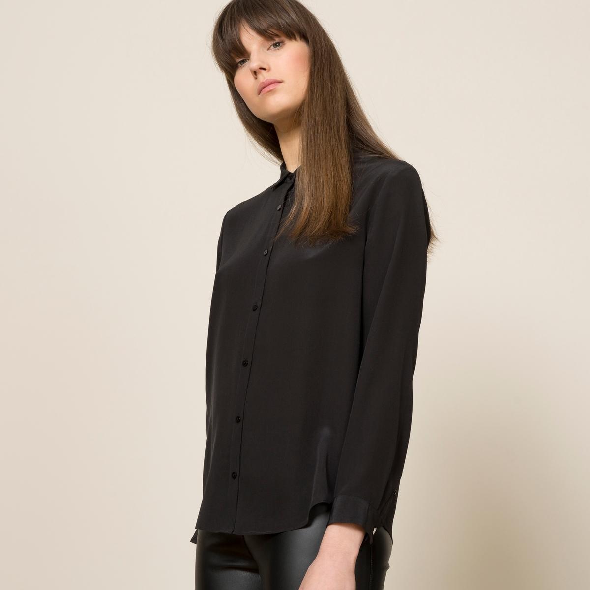 Блузка шелковаяБлузка THE KOOPLES, из шелка. Классический воротник. Длинные рукава на пуговице. Планка застёжки на пуговицы в том же цвете. Слегка закругленный низ. Складки сзади. Объемный покрой.Состав и описание           Материал : 100% шелкМарка : THE KOOPLES<br><br>Цвет: черный
