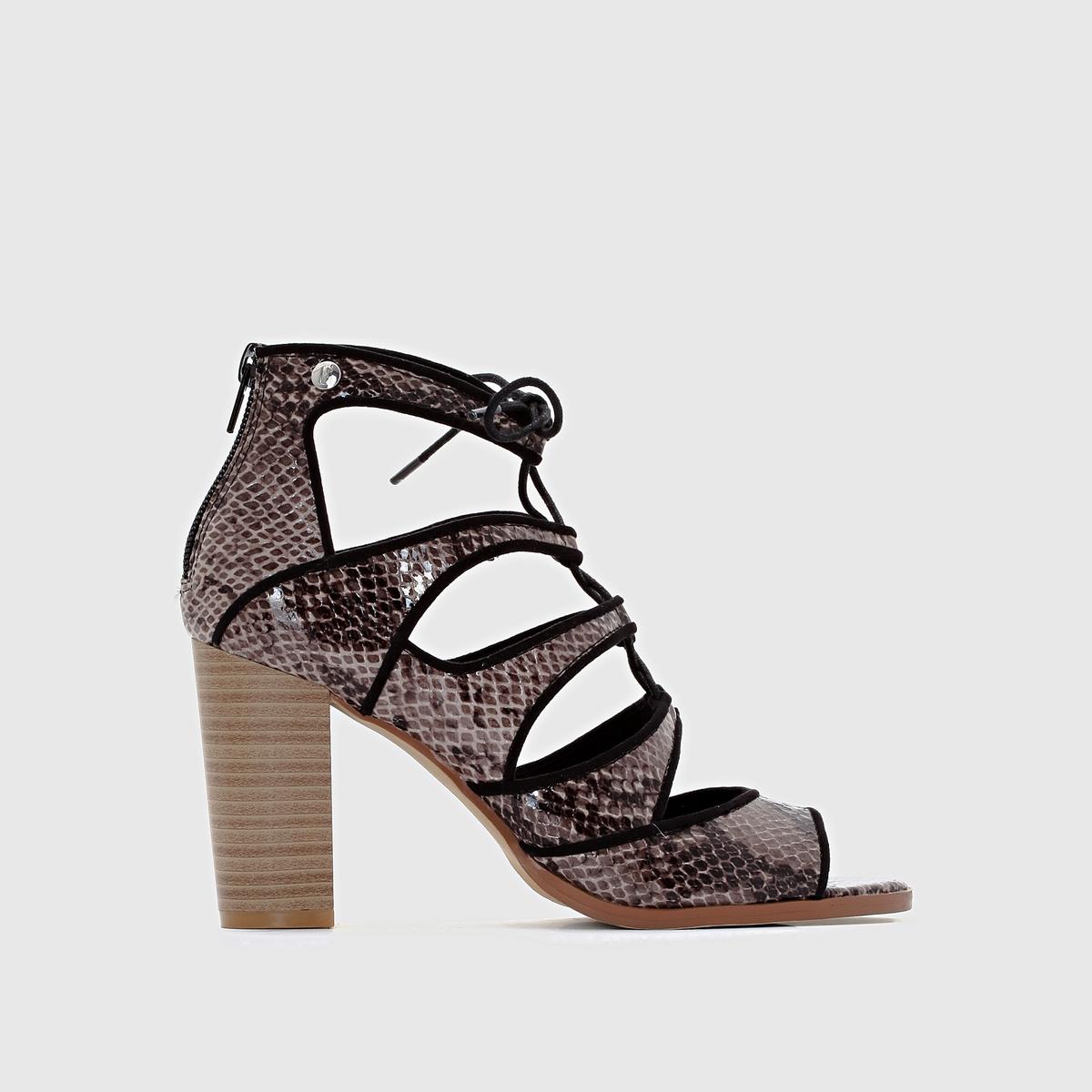 Босоножки на высоком каблуке ELLEБосоножки на высоком каблуке от ELLE - модель CARG?SE.Верх: синтетический материал.Подкладка: синтетический материал.Стелька: кожа.Подошва: синтетический материал.Застежка: молния сзади.<br><br>Цвет: черный/змеиный рисунок<br>Размер: 37
