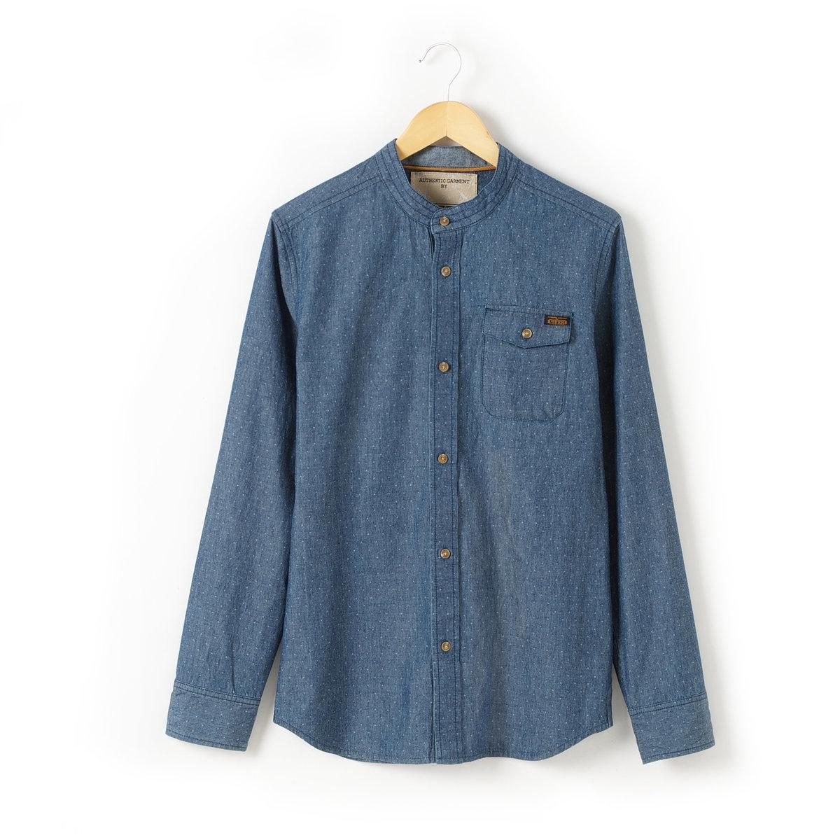 Рубашка без воротникаРубашка из ткани шамбре, 100% хлопка. Без воротника. Планка сперели и низ рукавов с застежкой на пуговицы. 1 карман на груди с клапаном на кнопке.<br><br>Цвет: потертый шамбре