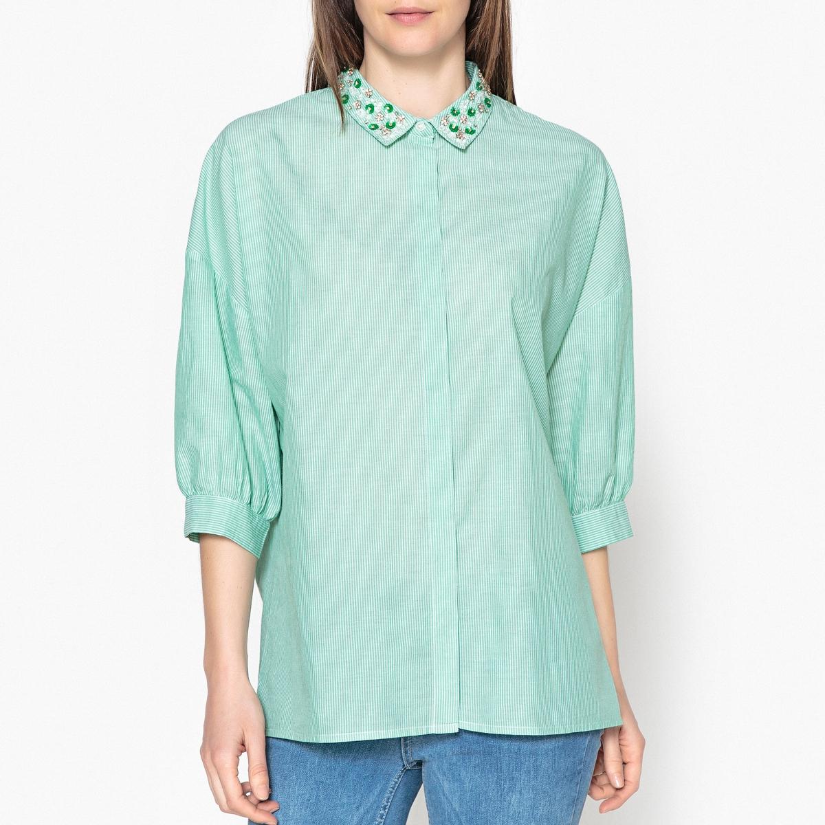 Рубашка в полоску PEPSAРубашка с рукавами 3/4 ESSENTIEL ANTWERP  - модель PEPSA. Воротник с украшениями в виде бусин.Детали •  Рукава 3/4 •  Прямой покрой •  Воротник-поло •  Рисунок в полоскуСостав и уход •  65% хлопка, 35% полиэстера •  Наполнитель : 85% стекла, 15% латуни •  Вторичный материал : 100% полиэстер •  Следуйте советам по уходу, указанным на этикетке<br><br>Цвет: зеленый