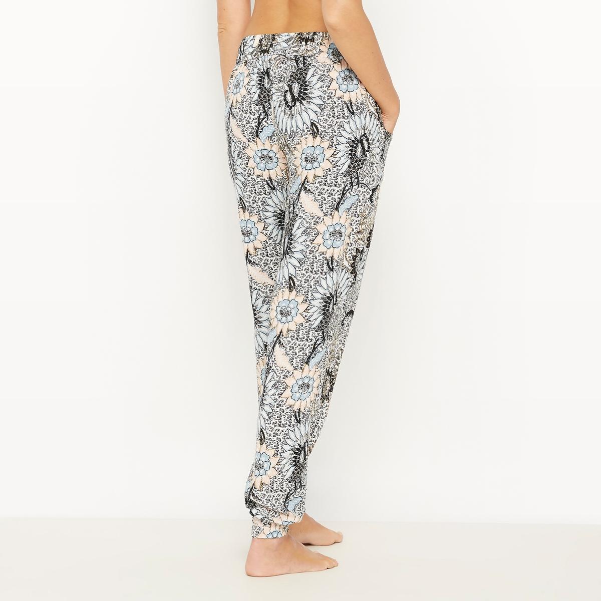 Брюки от пижамы хлопковые MARRAKESHХлопковые брюки от пижамы MARRAKESH от SKINY. Пижамные брюки с оригинальным сплошным рисунком. Удобный прямой покрой. 2 косых кармана по бокам. Эластичный пояс с завязками на кулиске. Состав и описаниеМатериалы : 100% хлопокМарка : SKINY<br><br>Цвет: Цветочный узор/черный