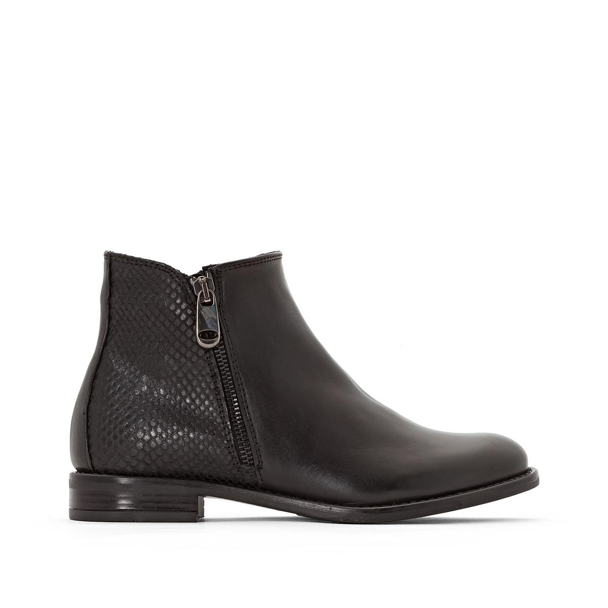 Ботинки кожаные на плоском каблуке TahisПодкладка : кожа Стелька : кожа Подошва : эластомер Высота каблука : 1 см. Высота голенища : 13 см Форма каблука : Плоская Мысок : закругленный Застежка : На молнию<br><br>Цвет: черный