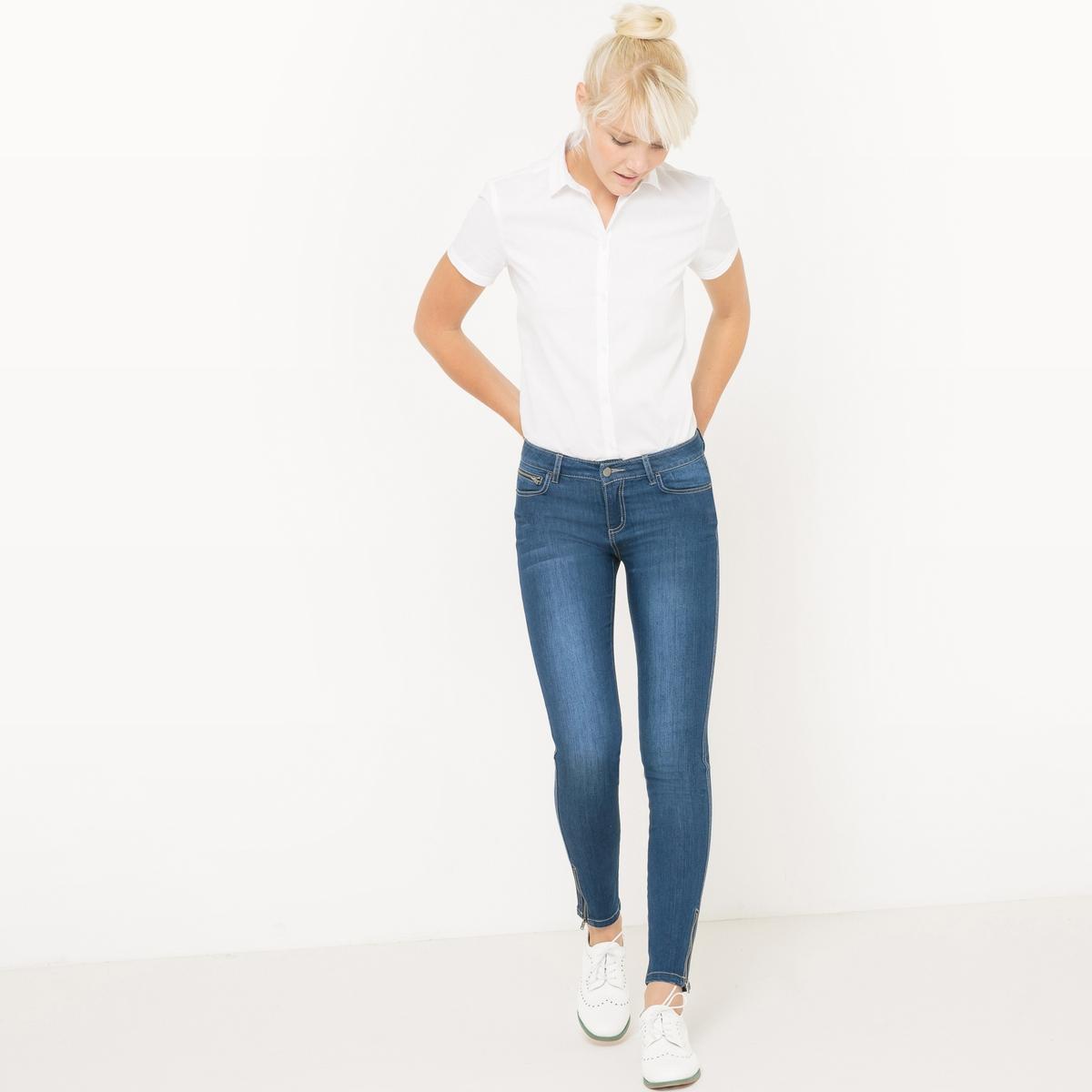 Рубашка из поплина с короткими рукавамиРубашка из поплина . Короткие рукава. Небольшой рубашечный воротник. Застежка на пуговицы. Слегка приталенный покрой. Слегка закругленный низ.  Состав и описаниеМатериалы : 69% хлопка, 28% полиамида,  3% эластанаДлина : 65 смМарка :      R ?ditionУходМашинная стирка при 30 °C Стирать с вещами схожих цветов Гладить при низкой температуре.<br><br>Цвет: белый,небесно-голубой,черный<br>Размер: 50 (FR) - 56 (RUS)