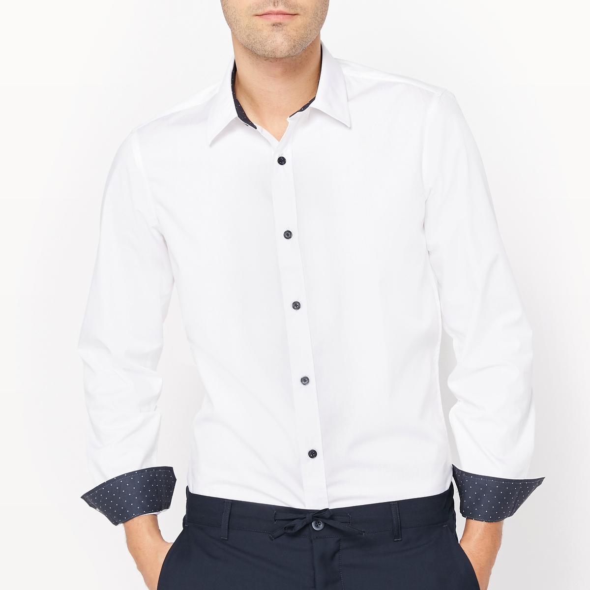 Рубашка узкого покрояРубашка. Детали с рисунком. Узкий покрой. длинные рукава. Итальянский воротник. Манжеты с застежкой на пуговицы.Состав и описаниеМатериал : 60% хлопка, 40% полиэстераДлина : 79 смМарка :      R ?ditionУходМашинная стирка при 30 °CСухая (химическая) чистка запрещенаОтбеливание запрещеноСтирка с вещами схожих цветовБарабанная сушка запрещена Гладить при средней температуре<br><br>Цвет: белый<br>Размер: 45/46