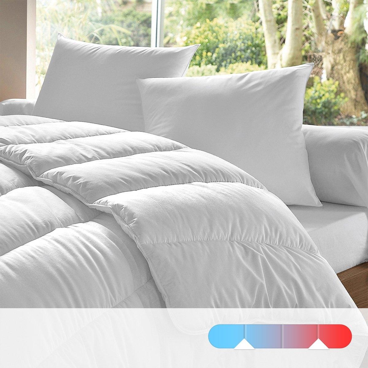 Одеяло двойное 4 сезона, 100% полиэстера, качество standardВнешняя часть из микрофибры 50% хлопка, 50% полиэстера, 80 г/м?, 68 нитей/см?, 100% полиэстера. Прострочка в линию. Отделка байкой с двойной прострочкой для укрепления. Стирка при 60°. Поставляется в чехле-чемоданчике.<br><br>Цвет: белый