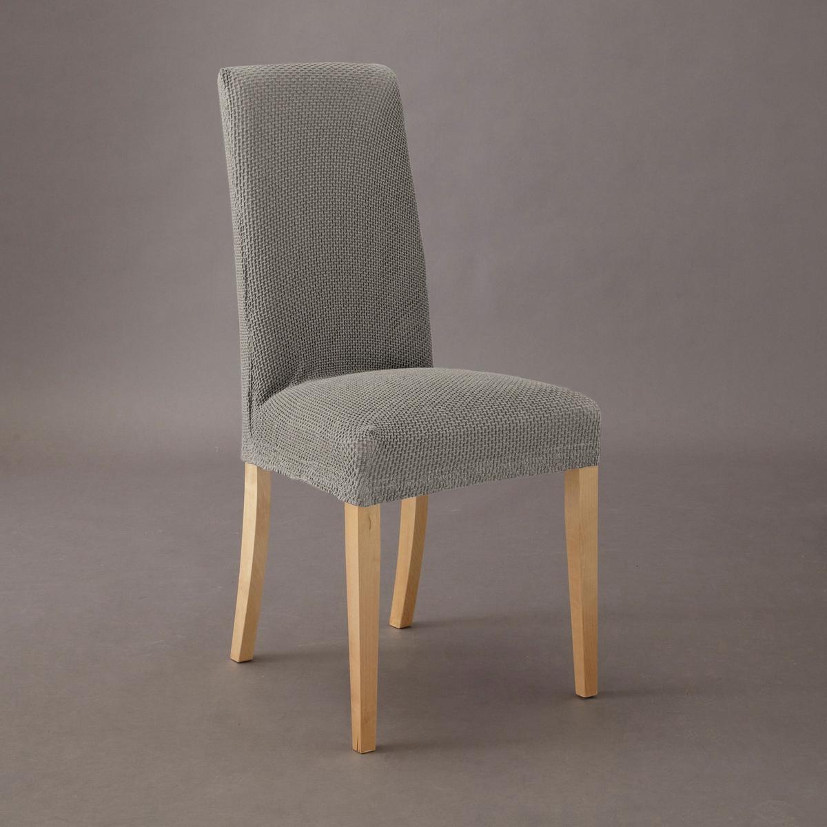 Чехол для стула АхмисОтличная идея для обновления интерьера! Сохраняет очертания стула и привносит новые мотивы в Ваш интерьер.Характеристики : -гофрированная ткань, 55% хлопка, 40% полиэстера, 5% эластана  стирка при 30° .  Эластичный низ, идеально обтягивает стул  !высота - 67см, ширина сиденья - 40 см, длина сиденья - 47см, высота переднего полотнища юбки - 17см.<br><br>Цвет: черный
