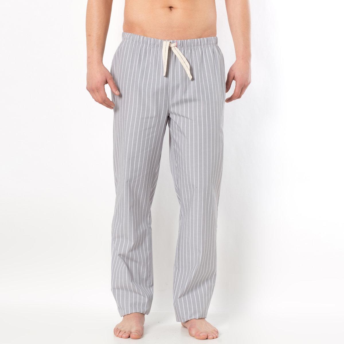Брюки домашние в полоскуДомашние брюки из поплина в полоску, 100% хлопка. Можно носить с домашней футболкой. Эластичный пояс с завязками. 1 накладной карман сзади.<br><br>Цвет: серый/в полоску<br>Размер: 40/42