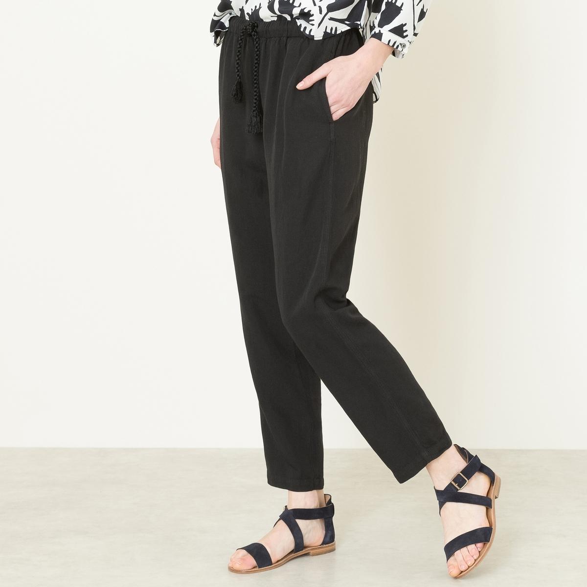 Брюки широкиеШирокие брюки POMANDERE - с эластичным поясом. Пояс с завязками на шнурок. Покрой широкий сверху и зауженный снизу. Струящаяся ткань с добавлением льна. Состав и описание   Материал : 79% вискозы, 21% льнаМарка : POMANDERE<br><br>Цвет: черный