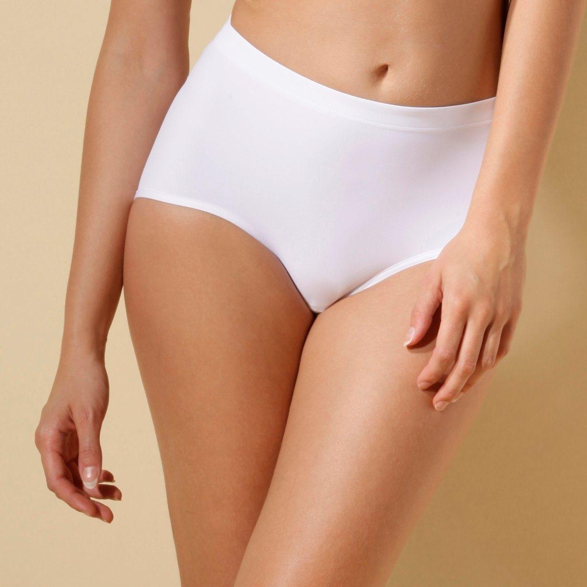 2 трусов с низкими вырезамиЛиния Shape от SLOGGI. Моделирующее белье, легкое и незаметное под одеждой. Без боковых швов. Ластовица на подкладке из хлопка. Мягкий трикотаж, 78% полиамида, 22% эластана. В комплекте 2 трусов. Машинная стирка при 30°.<br><br>Цвет: бежевый телесный,белый,черный<br>Размер: 42 (FR) - 48 (RUS).44 (FR) - 50 (RUS).40 (FR) - 46 (RUS).50 (FR) - 56 (RUS).46 (FR) - 52 (RUS)