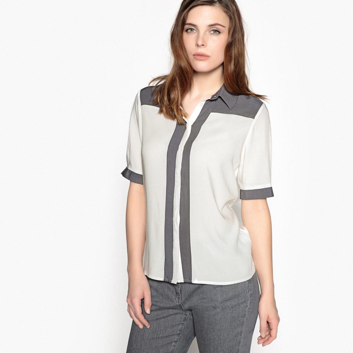 Блузка двухцветная с воротником-поло и рукавами 3/4Описание:Двухцветная блузка, рубашечный воротник. Оригинальная и женственная. Скрытая планка застежки на пуговицы. Короткие рукава, отделка контрастной лентой и разрезы. Детали •  Длина  : удлиненная модель •  Рукава 3/4 •  Прямой покрой •  Воротник-поло, рубашечный •  Графичный рисунокСостав и уход •  100% вискоза  •  Температура стирки 40° на деликатном режиме   •  Сухая чистка и отбеливатели запрещены •  Не использовать барабанную сушку • Средняя температура глажки Отрезные детали контрастного цвета на плечах, вдоль планки застежки на пуговицы и сзади. Длина. 62 см.<br><br>Цвет: экрю/серый