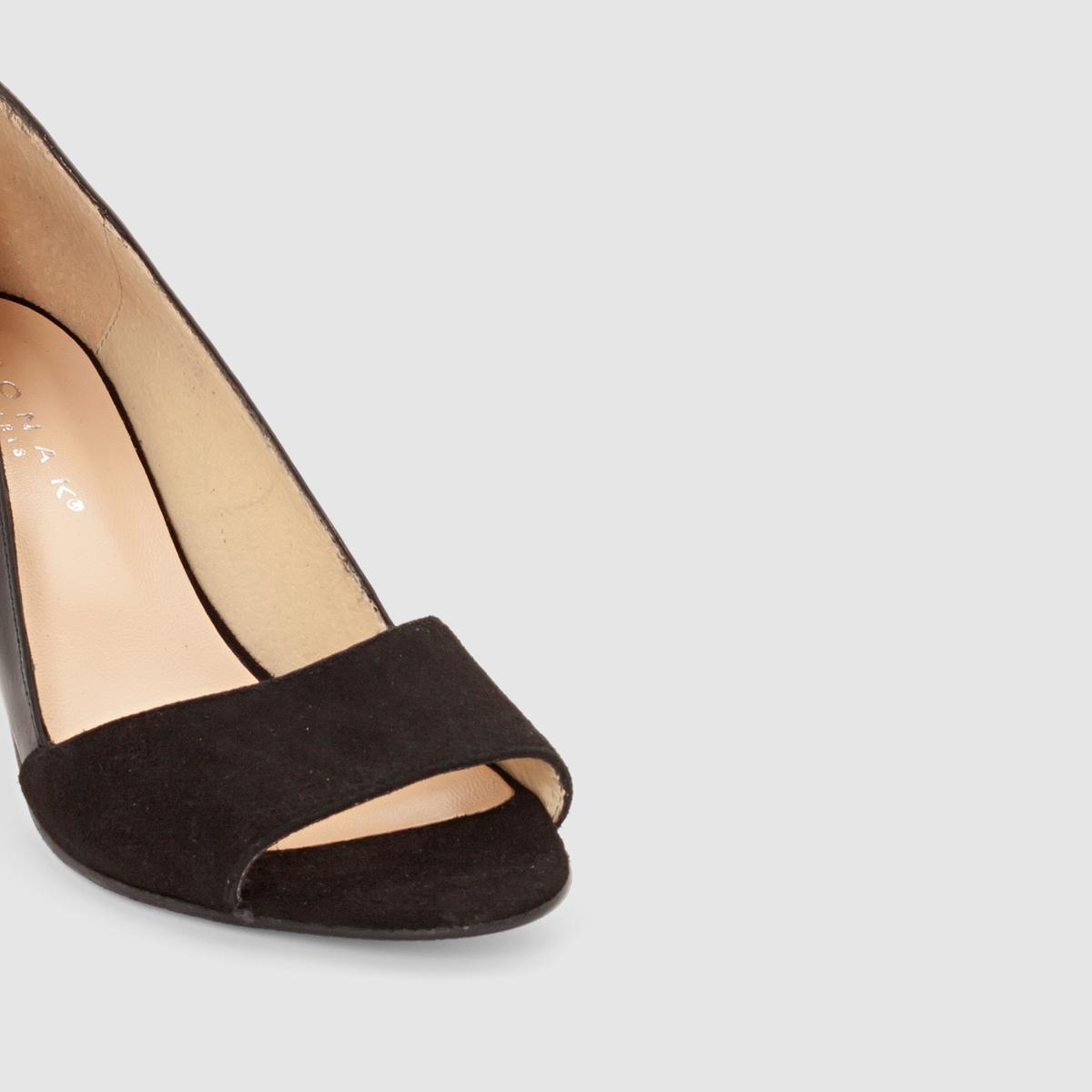 Туфли из двух материалов на каблукеТуфли на каблуке DORTA от JONAKВерх : велюр и яловичная кожаПодкладка :  кожаСтелька : кожаПодошва : из эластомераЗастежка : без застежки       Преимущества  : туфли на каблуке JONAK из двух материалов: блестящего и под замшу, элегантная и очень женственная форма.<br><br>Цвет: черный