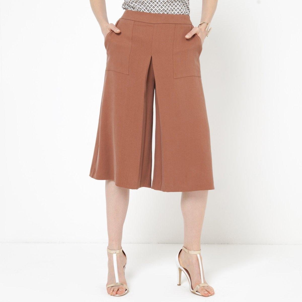 Юбка-брюкиЮбка-брюки из струящегося материала, 100% лиосела®. Застежка на скрытую молнию сзади. Косые карманы. Длина по внутр.шву 40 см. Ширина по низу 38 см.<br><br>Цвет: коньячный<br>Размер: 34 (FR) - 40 (RUS)