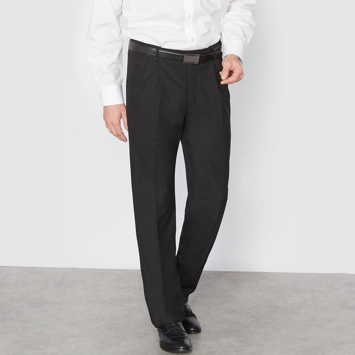 Брюки от костюма с защипами из ткани стретч, длина. 2Брюки можно носить с пиджаком, для создания элегантного и строгого ансамбля, или отдельно.Высококачественная слегка эластичная ткань, 62% полиэстера, 33% вискозы, 5% эластана. Подкладка 100% полиэстер.Длина 2 : при росте от 187 см. Пояс с потайной регулировкой для максимального комфорта и адаптации к любому обхвату талии. Застежка на молнию, пуговицу и крючок. 2 косых кармана. 1 прорезной карман с пуговицей сзади. Необработанный низ. Длина 2 : при росте от 187 см :- Длина по внутр.шву : 91,8-94,8 см, в зависимости от размера. - Ширина по низу : 21,9-27,9 см, в зависимости от размера. Есть также модель длины 1 : при росте до 187 см. Есть также модель без защипов.<br><br>Цвет: антрацит,темно-синий,черный<br>Размер: 62.46 (FR) - 52 (RUS).56.60.62.68.62.72