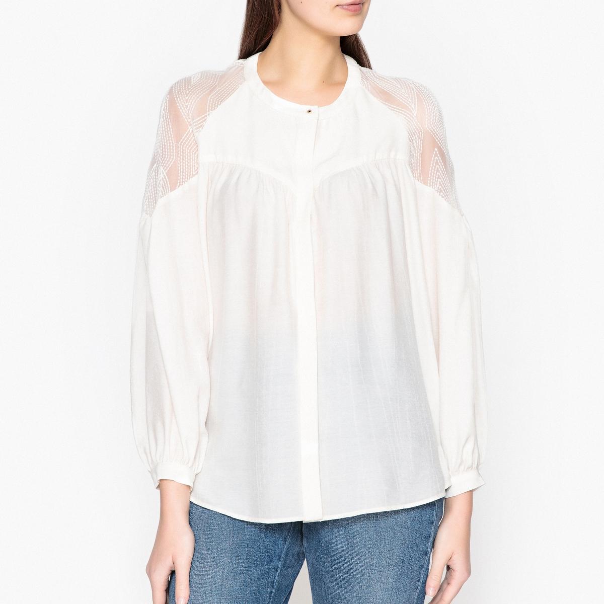 Рубашка с оригинальными плечами BAPTISTINEОписаниеРубашка SESSUN  - модель BAPTISTINE. Прозрачные оригинальные вставки на плечах. Сборки и супатная застёжка на пуговицы спереди. Детали •  Рукава 3/4 •  Прямой покрой •  Воротник-поло, рубашечныйСостав и уход •  75% вискозы, 25% полиэстера •  Следуйте советам по уходу, указанным на этикетке •  Присборенные манжеты с застежкой на пуговицу •  Закругленный низ<br><br>Цвет: экрю<br>Размер: L