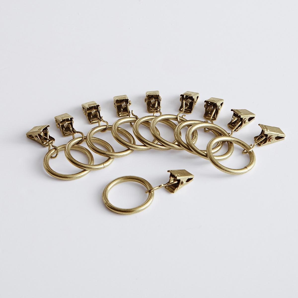 Кольца с зажимами для штор ONEGA (10 шт.)Комплект из 10 колец с зажимами для штор Onega.  Быстрый и современный способ повесить шторы. Из металла. Внутренний диаметр кольца 2,5 см.<br><br>Цвет: старинная латунь