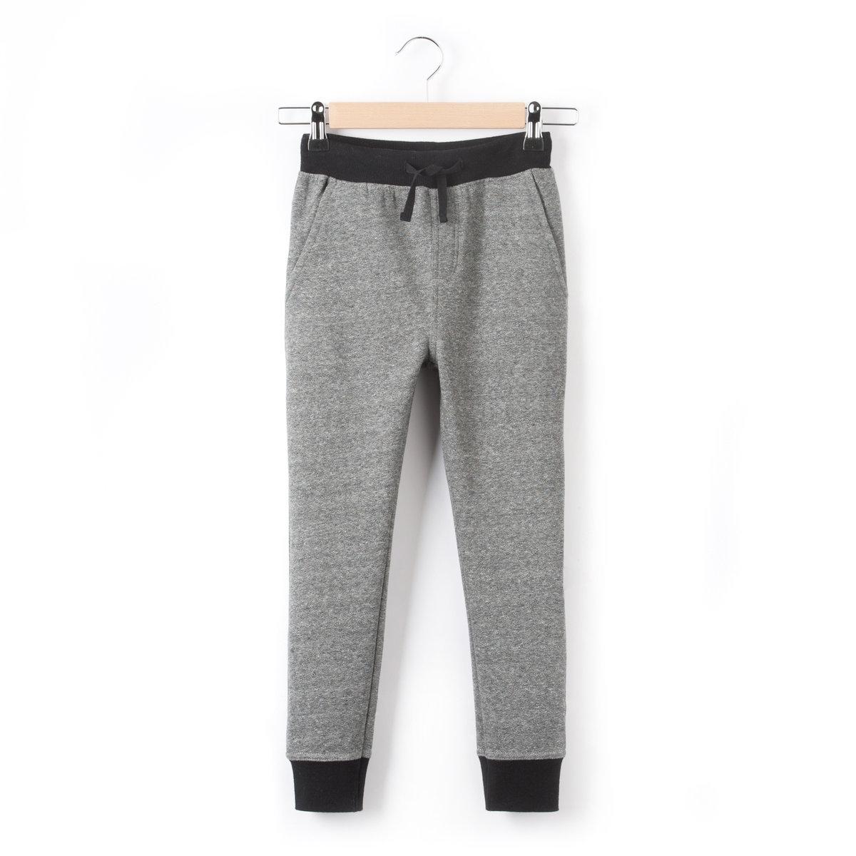 Брюки спортивныеСпортивные брюки из мольтона, 80% хлопка, 20% полиэстера. Эластичный пояс с завязками. 2 боковых кармана. Низ брючин со сборками.<br><br>Цвет: серый меланж<br>Размер: 12 лет -150 см