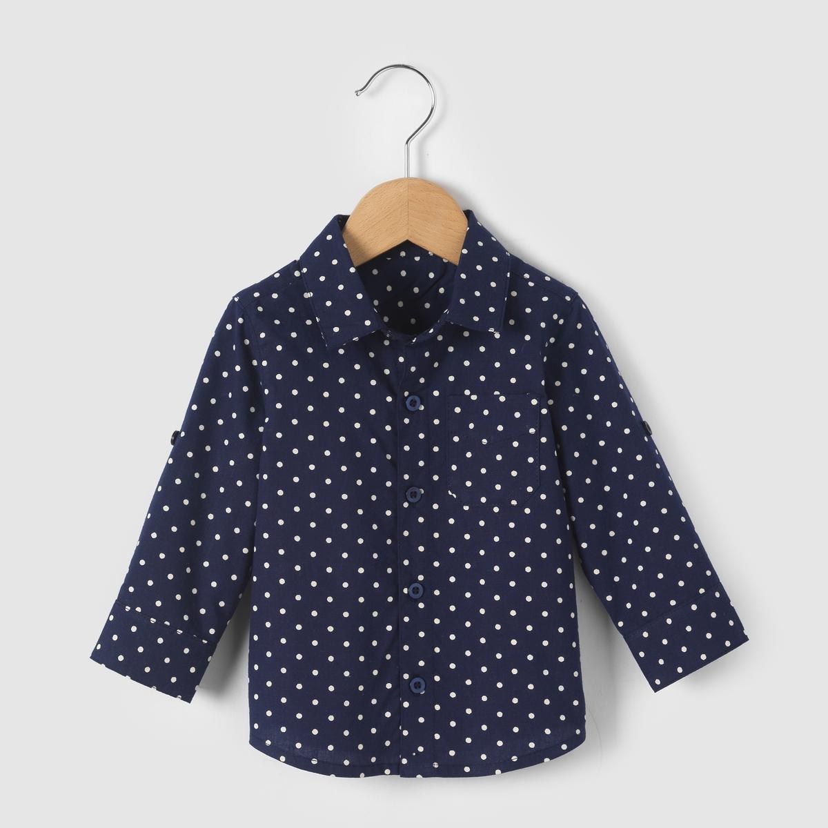 Рубашка в горошек, возраст 1 мес- 3  годаРубашка в горошек. Нагрудный карман. Застежка на пуговицах спереди и на манжетах  . Вырез сзади со складкой .Состав и описаниеМатериал       100% хлопок- Марка: R mini.Уход- Стирать и гладить с изнанки.Машинная стирка при 30°С на умеренном режиме с одеждой схожих цветов- Машинная сушка в умеренном режиме- Гладить при средней температуре..<br><br>Цвет: в горошек<br>Размер: 3 мес. - 60 см