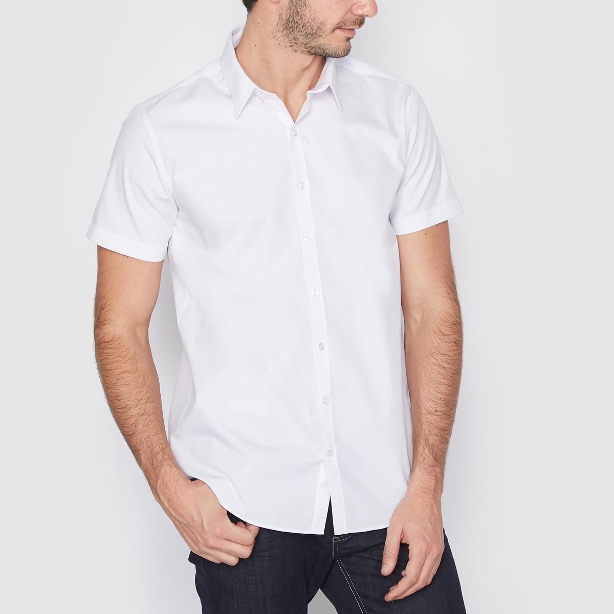 Рубашка однотонная прямого покрояРубашка с короткими рукавами, прямой покрой, воротник со свободными уголками. Длина 77 см. Легкая глажка.Закругленный низ. 55% хлопка, 45% полиэстера.<br><br>Цвет: белый,темно-синий,черный<br>Размер: 43/44.35/36.47/48.43/44