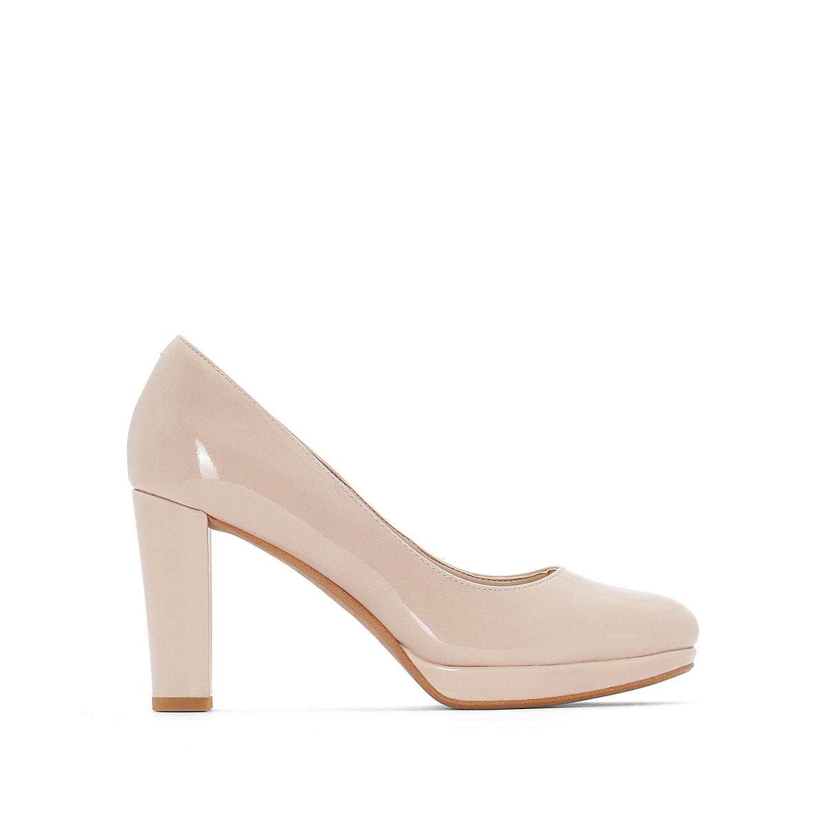 Туфли из лакированной кожи Kendra SiennaВерх : Кожа.   Подкладка : синтетика   Стелька : Кожа.   Подошва : Каучук   Высота каблука : 9 см   Форма каблука : квадратный.   Мысок : закругленный   Застежка : Без застежки<br><br>Цвет: бежевый лак
