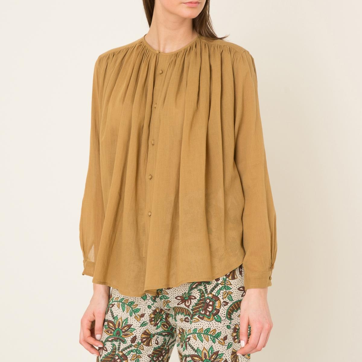 Рубашка объемнаяРубашка объемная  LAURENCE BRAS из хлопка .  Без воротника. Сборки ниже отрезных деталей на плечах . Обтянутые пуговицы. Длинные рукава. Закругленный низ. Состав и описание   Материал : 100% хлопок   Марка : LAURENCE BRAS<br><br>Цвет: зеленый,темно-бежевый