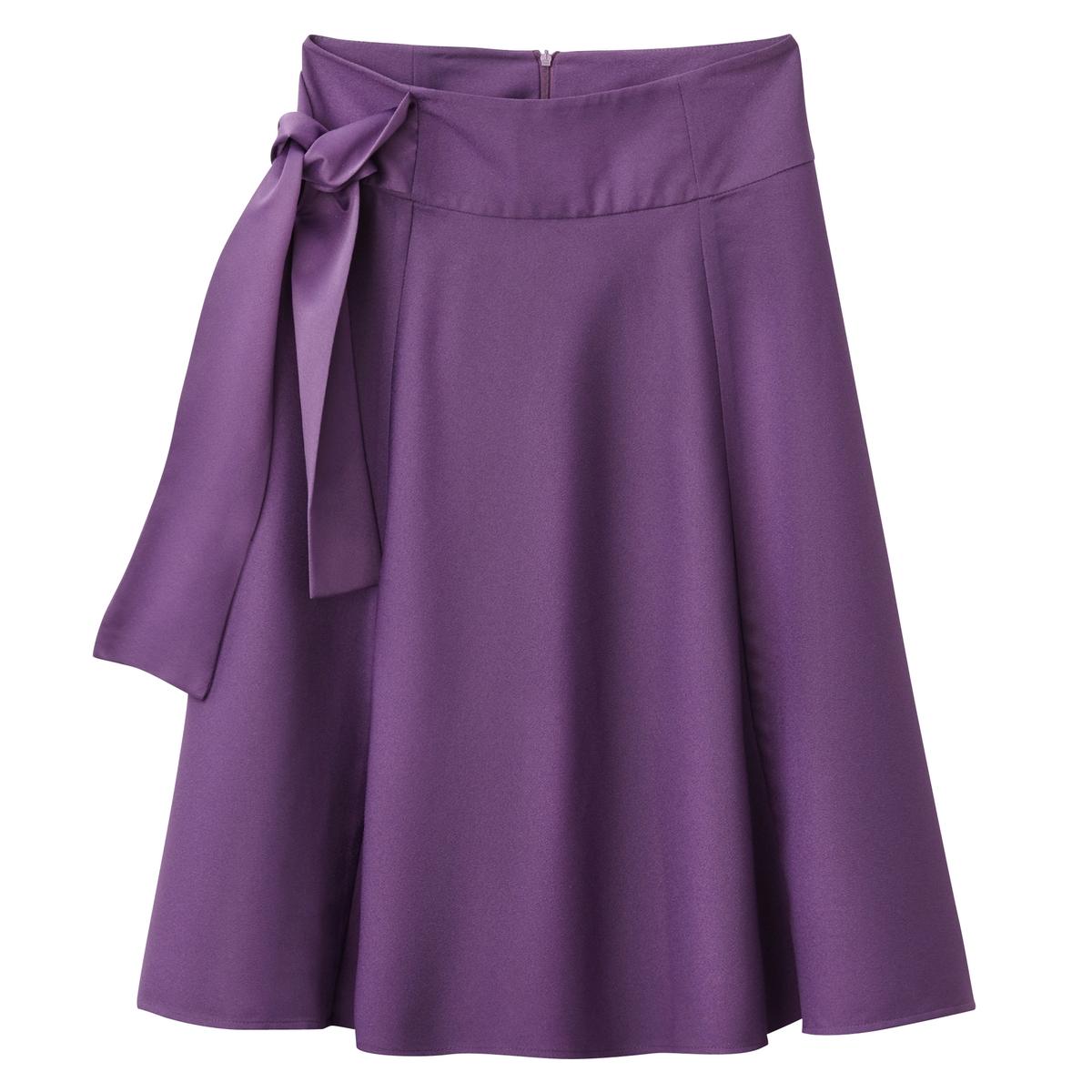 Falda midi con lazada a un lado