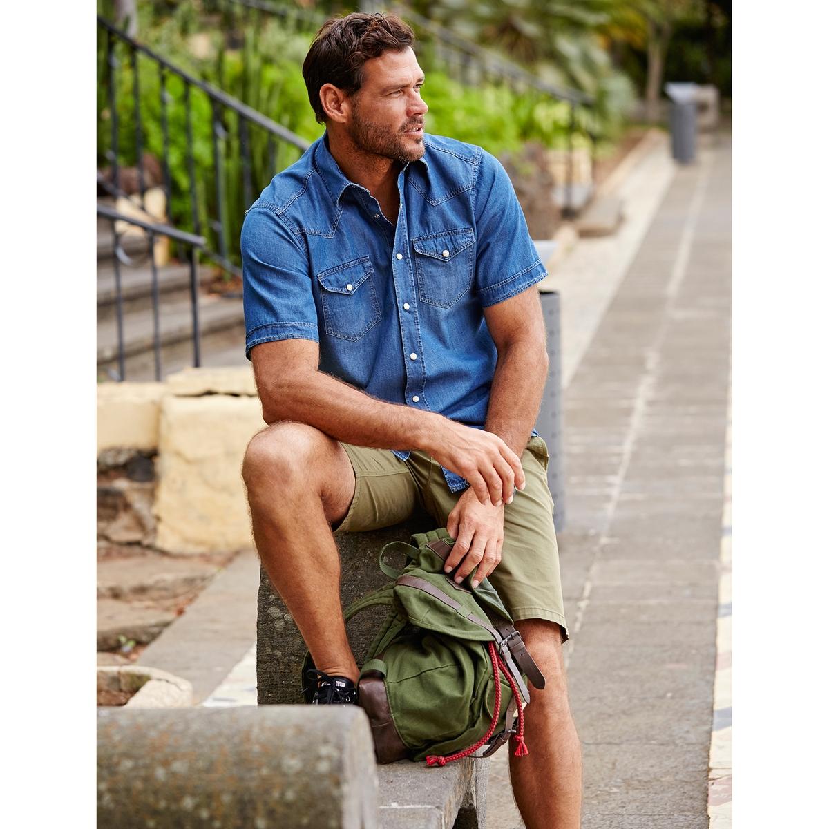 Рубашка джинсовая, 100% хлопокРубашка джинсовая с короткими рукавами JP1880, стильный вытертый эффект и невероятный комфорт . Воротник Kent casual, 2 кармана с клапанами на кнопках-пуговицах, короткие рукава с отворотами. 100% хлопок. Немного приталенный покрой, позволяющий носить ее также поверх брюк. Длина в зависимости от размера. 78 - 94 см<br><br>Цвет: синий джинсовый<br>Размер: XXL.XL