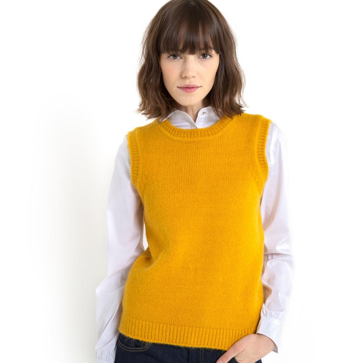 Пуловер без рукавовЯркая модель цвета шафран! Пуловер без рукавов. Закругленный вырез. Низ, вырез и края рукавов связаны в рубчик. 54% полиэстера, 41% акрида,5% шерсти. Длина. 50 см.<br><br>Цвет: шафран<br>Размер: 30/32 (FR) - 36/38 (RUS)