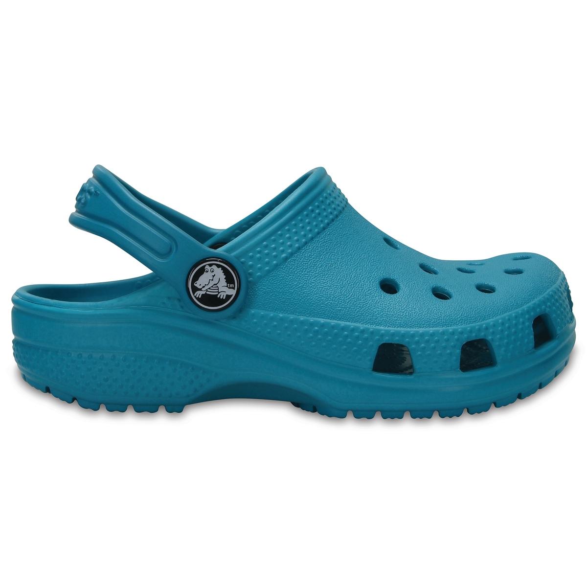 Сабо Classic Clog KidsДетали •  Сабо •  Высота каблука : 1,5 см •  Застежка : ремешок/пряжка •  Круглый мысок •  Гладкая отделкаСостав и уход •  Верх 100% синтетический материал •  Подошва 100% синтетический материал<br><br>Цвет: бирюзовый,темно-синий<br>Размер: 24/25