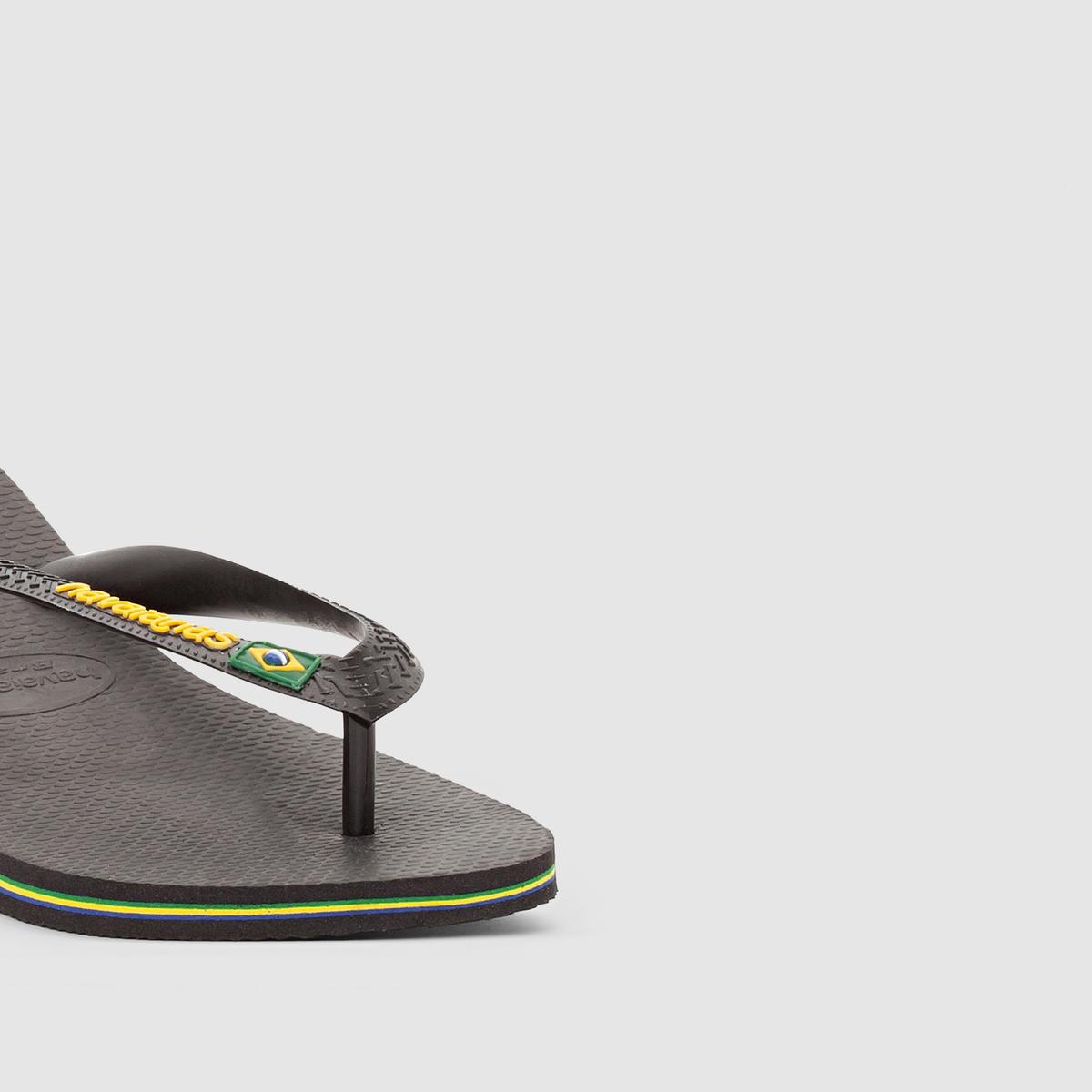 Вьетнамки Brazil LogoВерх : каучук         Стелька : каучук         Подошва : каучук         Застежка : без застежки         Преимущества : Вьетнамки HAVAINAS с мельчайшими деталями, выполненными в бразильском стиле, наслаждайтесь ими этим летом<br><br>Цвет: черный
