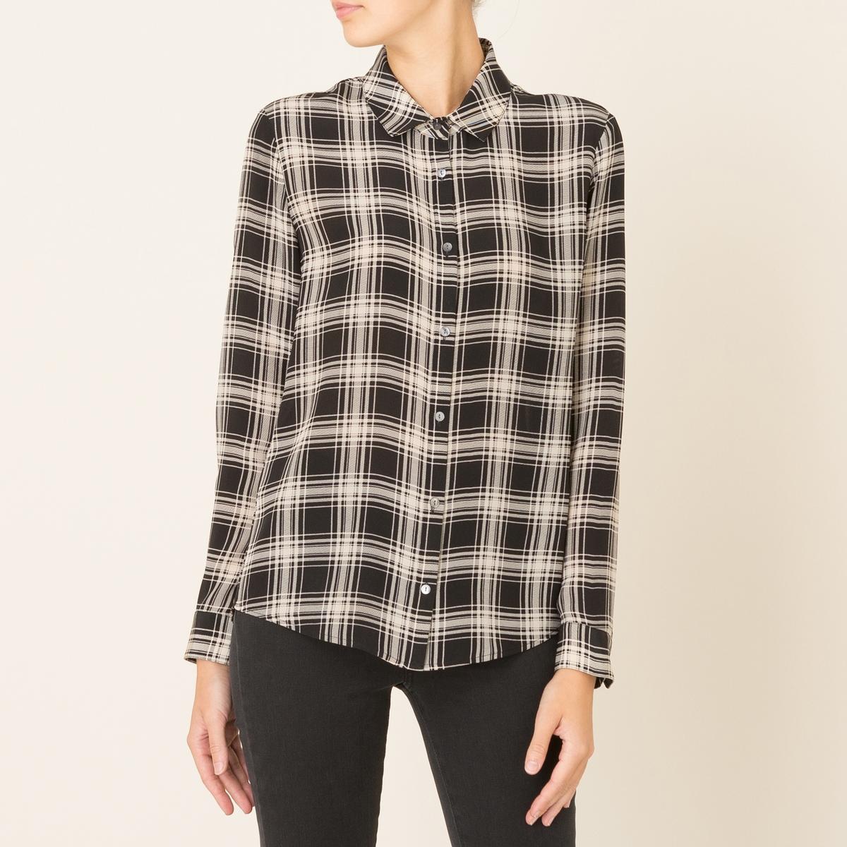 Рубашка женская из шелкаРубашка THE KOOPLES, из шелка . Классический воротник. Длинные рукава с застежкой на пуговицы. Планка застежки на пуговицы . Складка на спинке. Квадратный мотив рисунка. Струящийся покрой. Состав и описание Материал : 100% шелк Марка : THE KOOPLES<br><br>Цвет: белый/ черный
