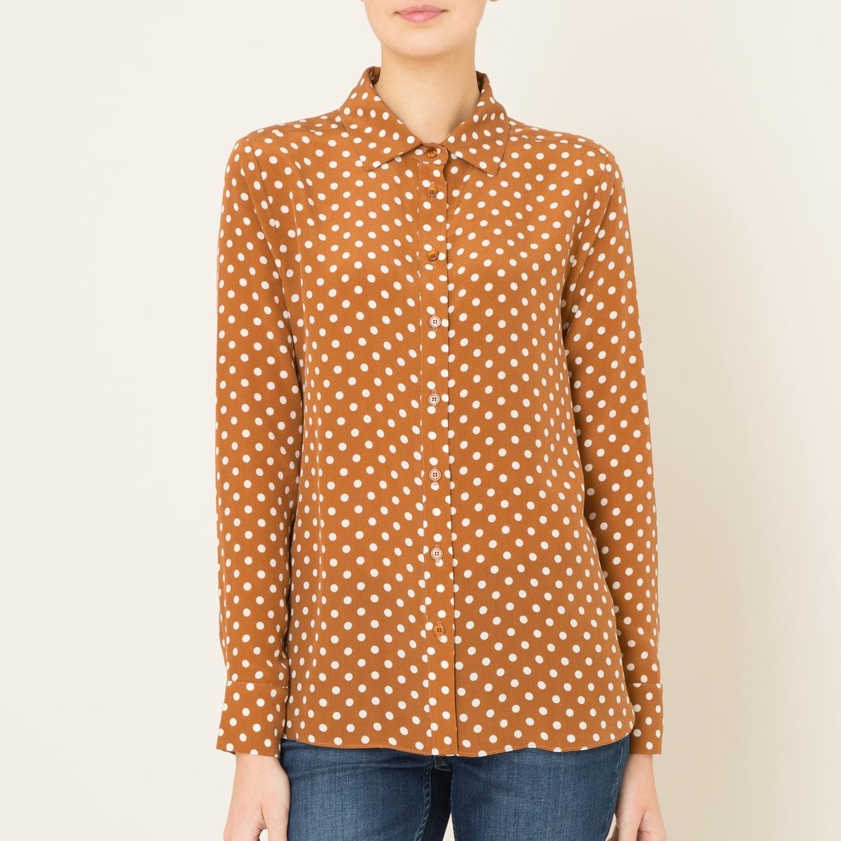 РубашкаРубашка в горох TOUPY - модель GASPAR из 100% шелка. Рубашечный воротник. Сплошной рисунок в горох. Застежка на пуговицы спереди. Длинные рукава. Состав и описание Материал : 100% шелкМарка : TOUPY<br><br>Цвет: каштановый