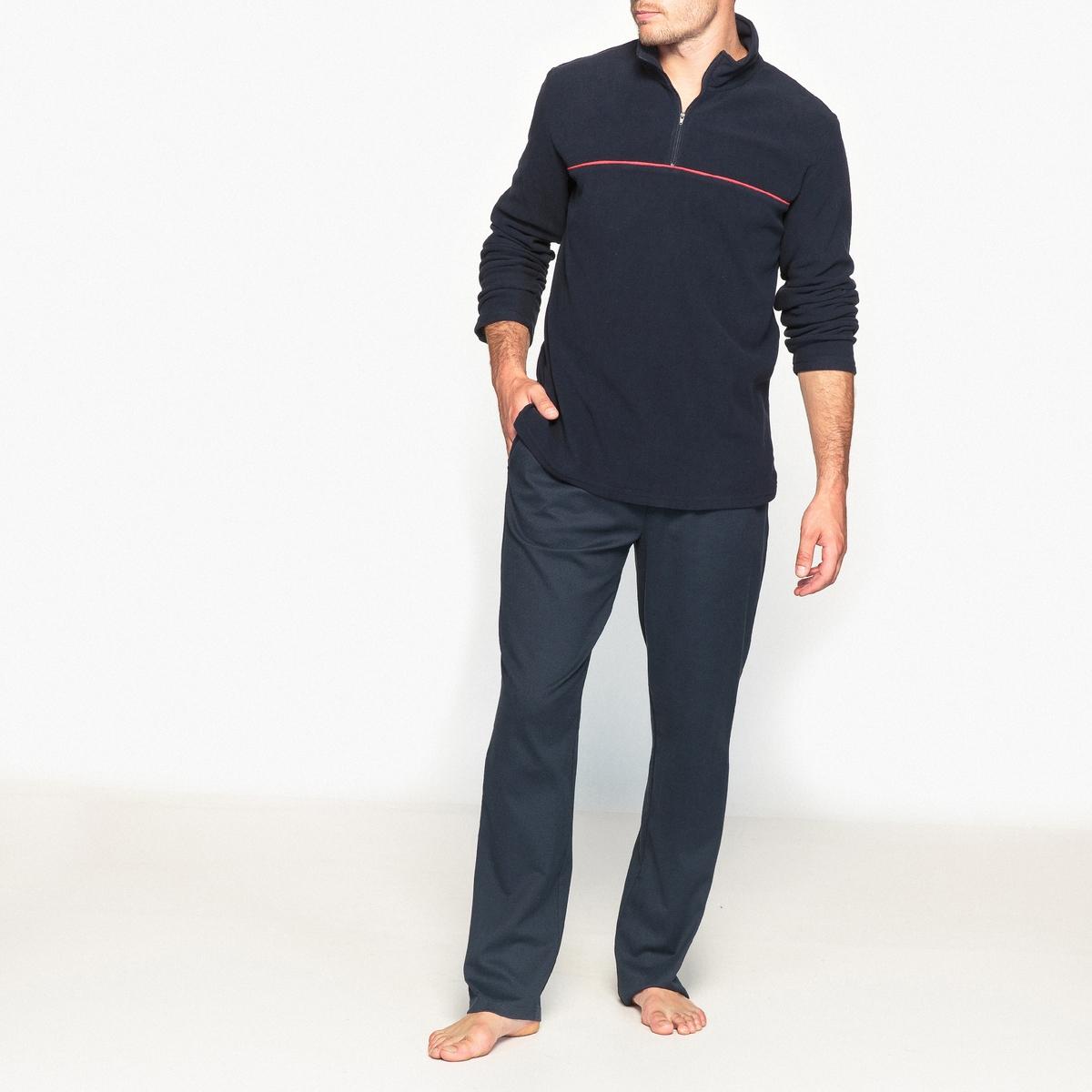 Брюки пижамные из микрофлисаПижамные брюки из микрофлиса : очень мягкие и комфортные. Удобная модель благодаря эластичному поясу с затягиваемым шнурком. Вырез с застежкой на молнию.Описание •  Прямой покрой.  •  Эластичный пояс с затягиваемым шнурком •  2 боковых кармана •  Брюки можно носить с футболкойСостав и уход •  Основной материал : микрофлис, 100% полиэстера •  Машинная стирка при 30 °С •  Стирать с вещами схожих цветов<br><br>Цвет: темно-синий/ красный