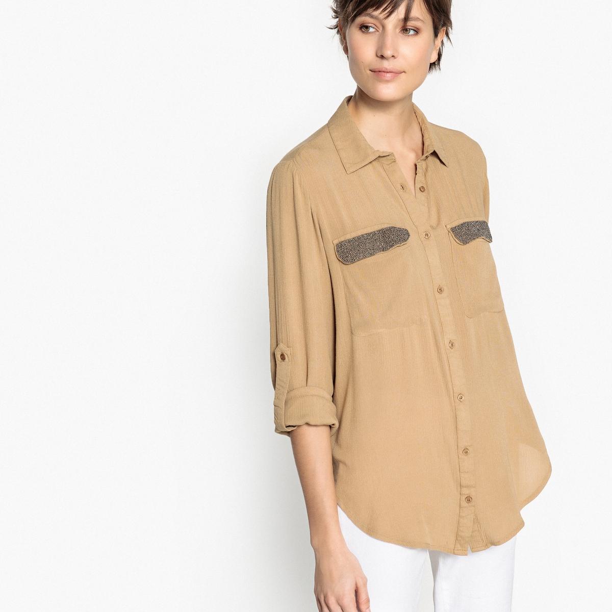Рубашка однотонная прямого покроя с воротником-полоОписаниеДетали •  Длинные рукава •  Прямой покрой •  Воротник-поло, рубашечныйСостав и уход •  100% вискоза •  Следуйте советам по уходу, указанным на этикетке<br><br>Цвет: песочный