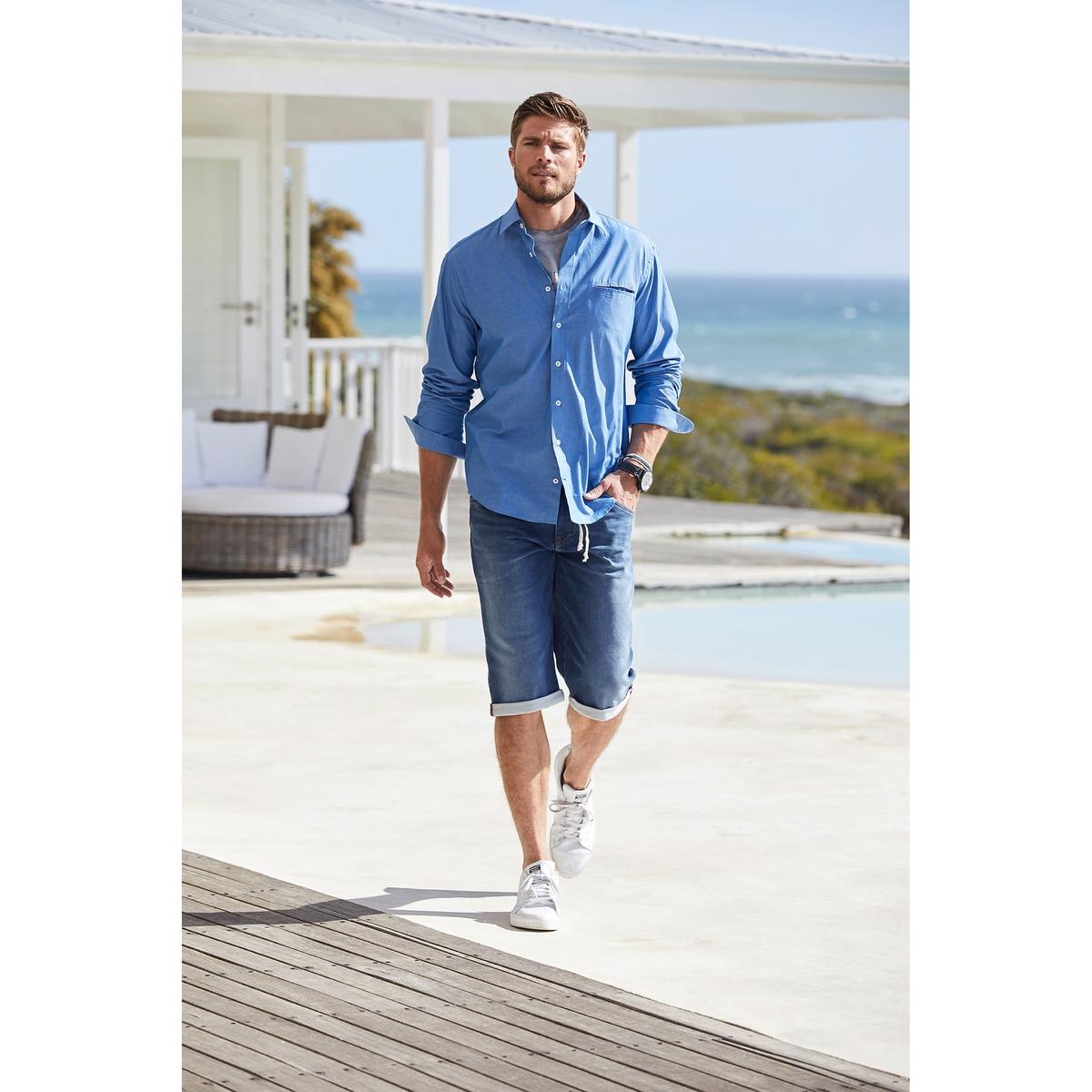 Рубашка однотонная с длинными рукавамиОписание:Детали •  Длинные рукава •  Прямой покрой  •  Классический воротникСостав и уход •  100% хлопок •  Следуйте советам по уходу, указанным на этикеткеТовар из коллекции больших размеров<br><br>Цвет: синий<br>Размер: 7XL