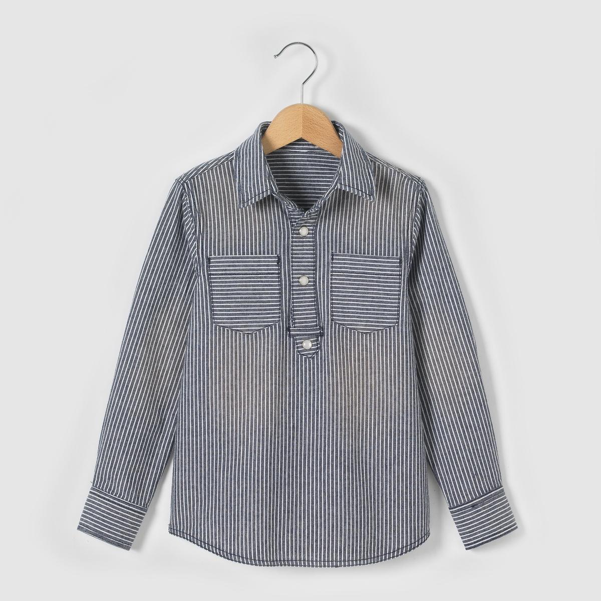 Рубашка в полоску в стиле матросской блузы,  3-12 летРубашка в полоску с длинными рукавами в стиле матросской блузы. Воротник и рукава с планкой застёжки на кнопки. 2 нагрудных кармана. Рисунок сзади. Состав и описание : Материал: Шамбре из 100% хлопкаУход :Машинная стирка при 30°C на умеренном режиме с одеждой подобных цветов.Стирать и гладить с изнаночной стороны.Машинная сушка на умеренном режиме.Гладить на средней температуре.<br><br>Цвет: в полоску синий/белый