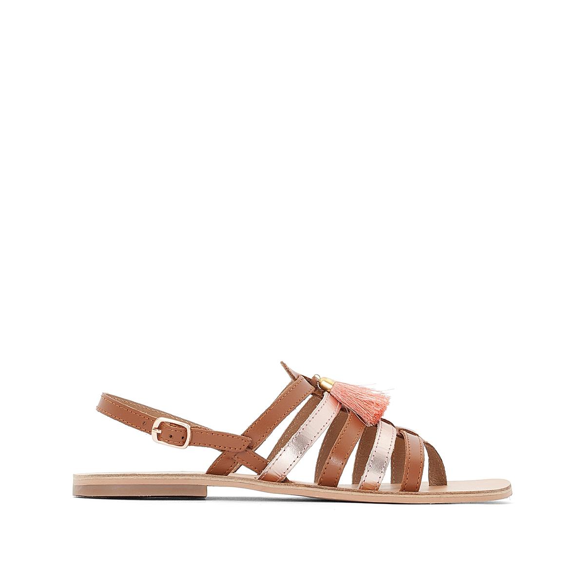 Босоножки кожаные с кисточками на плоском каблуке