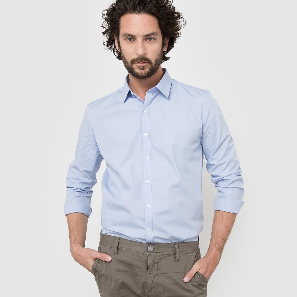 Рубашка однотонная прямого покрояРубашка прямого покроя с длинными рукавами. Длина 77 см.   Легкая глажка.Низ рукавов с застежкой на пуговицы. 55% хлопка, 45% полиэстера.<br><br>Цвет: небесно-голубой,темно-синий,черный<br>Размер: 41/42.35/36.41/42.43/44.35/36
