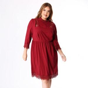 Halflange wijd uitlopende jurk met macramé details