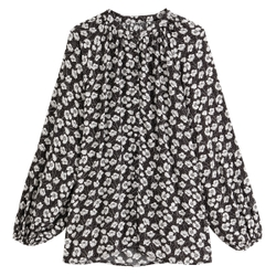 Blusa holgada de manga larga con cuello redondo y estampado