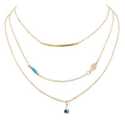 Collier doré multichaines aux perles turquoises et breloques