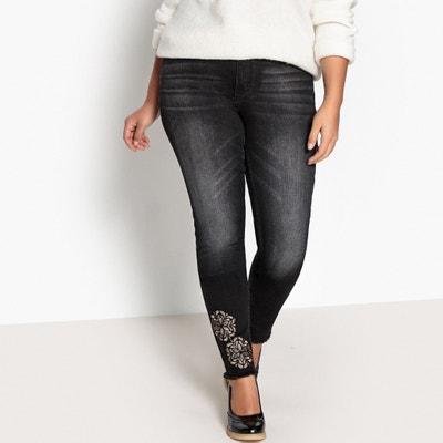 Jeans slim, patch a fiori al fondo di una gamba Jeans slim, patch a fiori al fondo di una gamba CASTALUNA