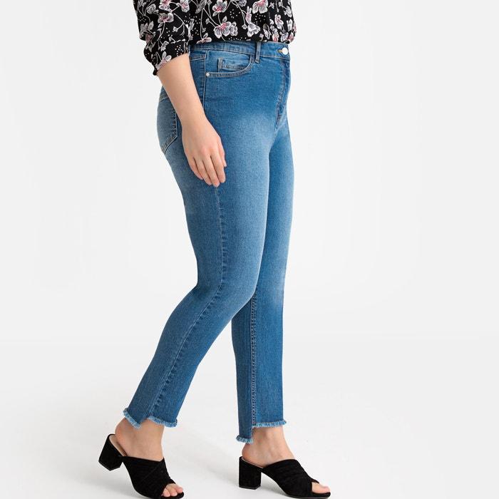 Jeans slim, fondo finitura tagli grezzi
